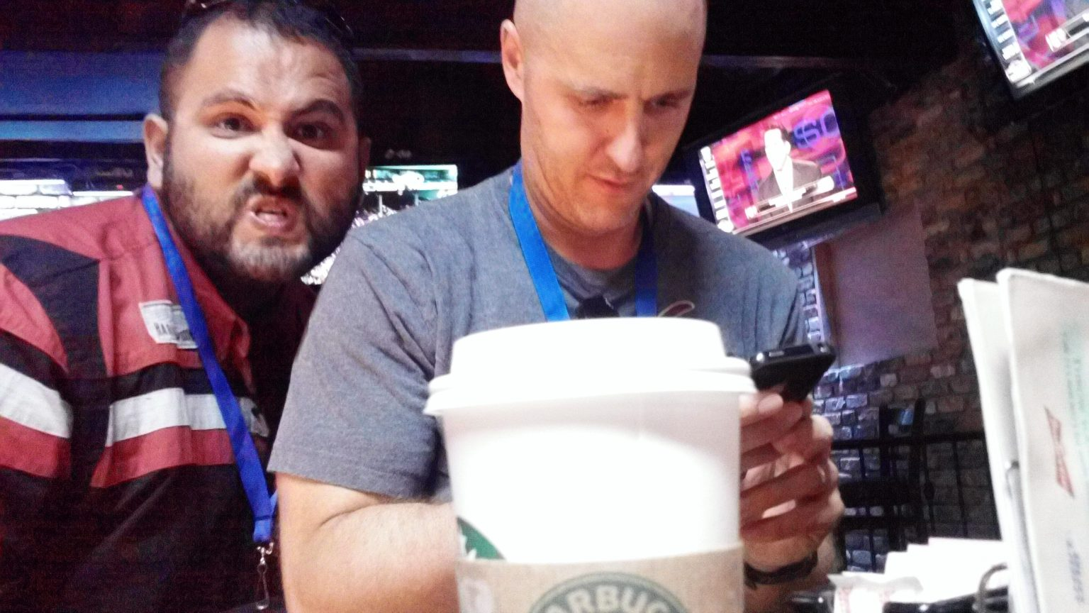 Artistic shot of Tony and Brian, with a Starbucks cup in the foreground