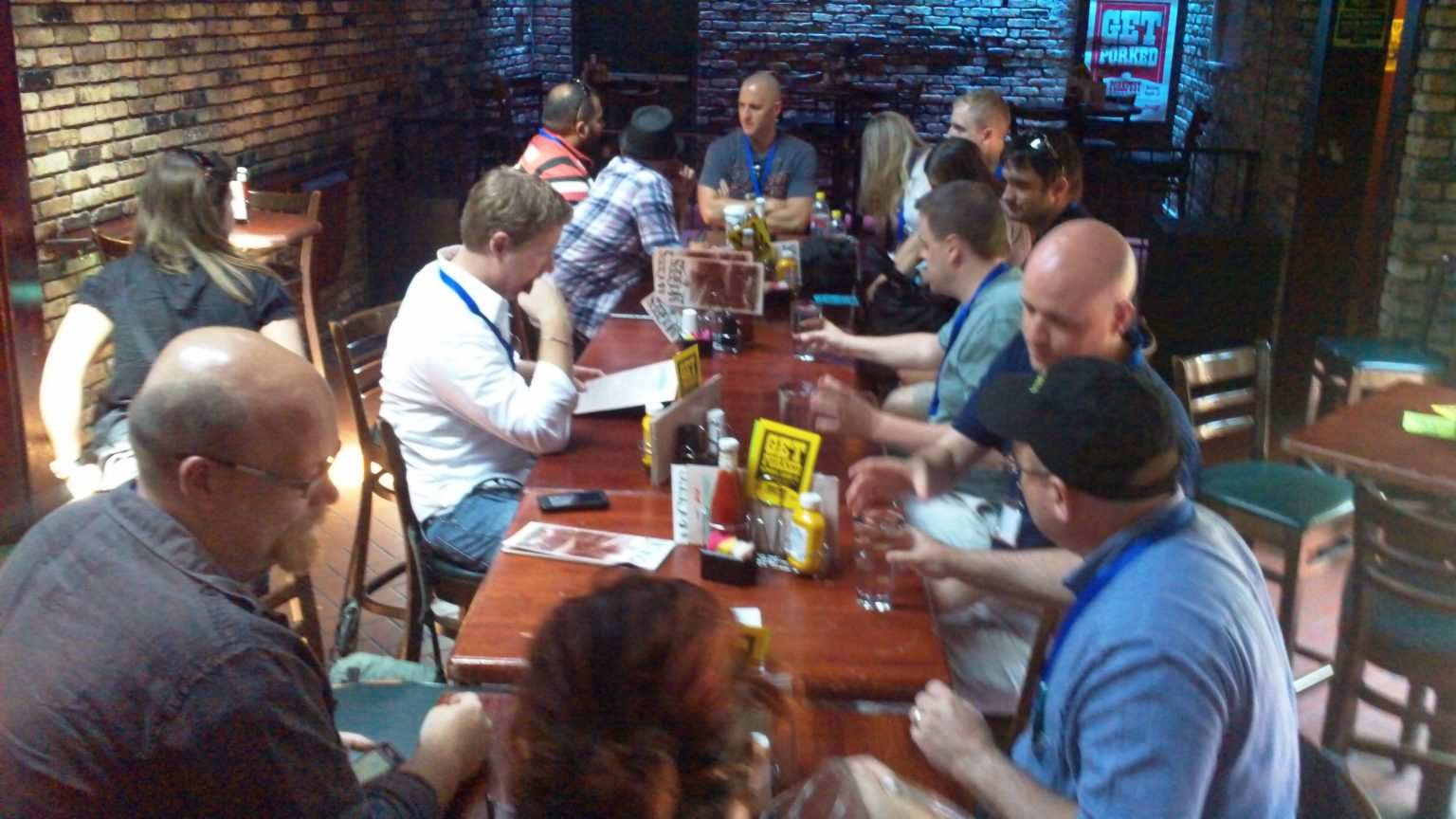 Photo of people sitting around awaiting lunch in a bar