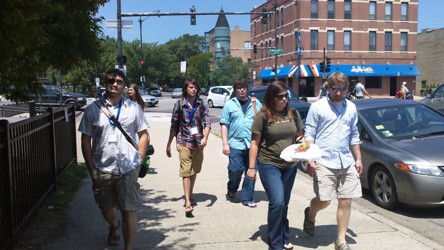 Group of people walking along the sidewalk