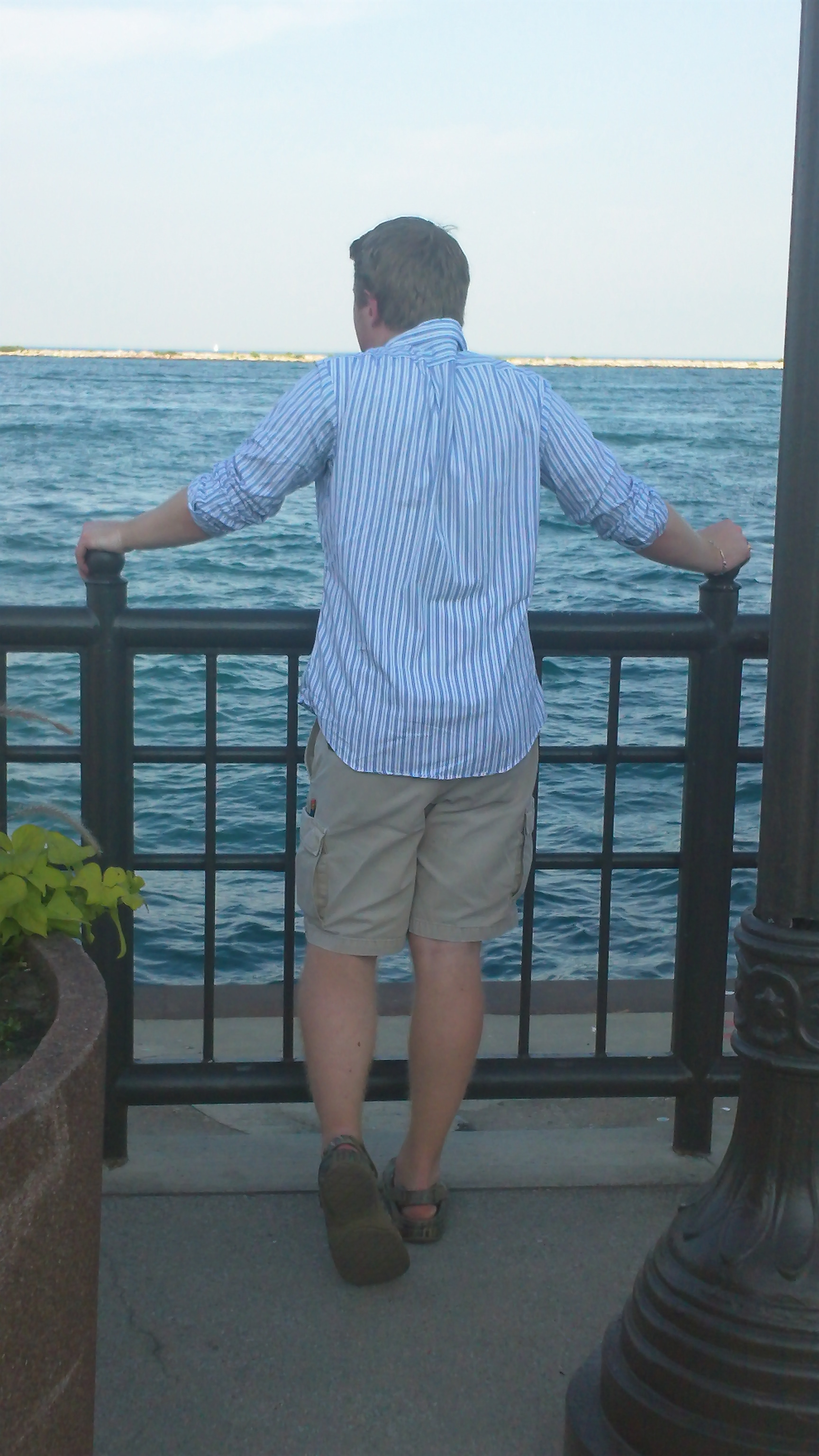Jared with his back to the camera looking out over the water